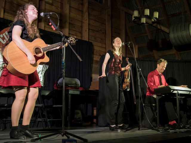 Ross Family singing on stage at Clinton Hills, PEI